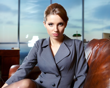 pepsico: Business woman in an office environment with large stained-glass window on background  Stock Photo