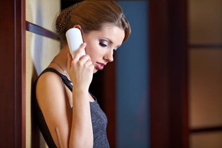 flirting: A young woman flirting and chatting on the phone