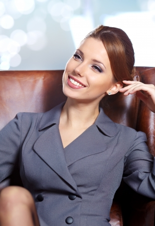 financial leadership: business woman in modern glass interior