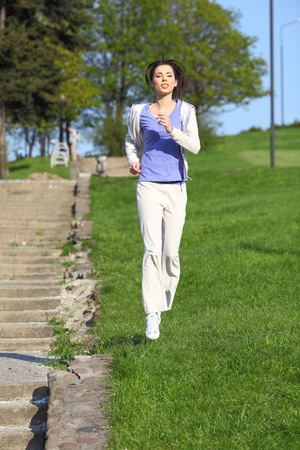 jogging track: Fitness Girl running in the park  Stock Photo