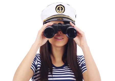 Close-up portrait of a woman as a sea captain holding binocular photo