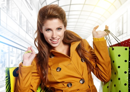 Beautiful shopping woman at a drawn mall  photo