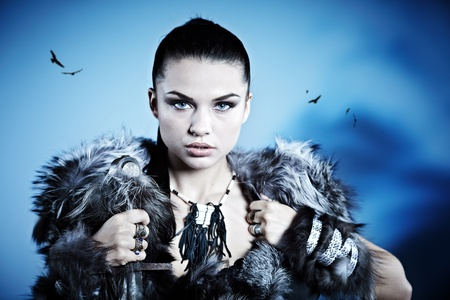 aggressive people: Warrior woman. Fantasy fashion idea.  Stock Photo