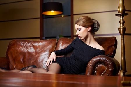 Beautiful elegant woman in a luxury hotel  photo