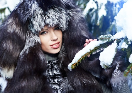 Beauty woman in the winter scenery  photo