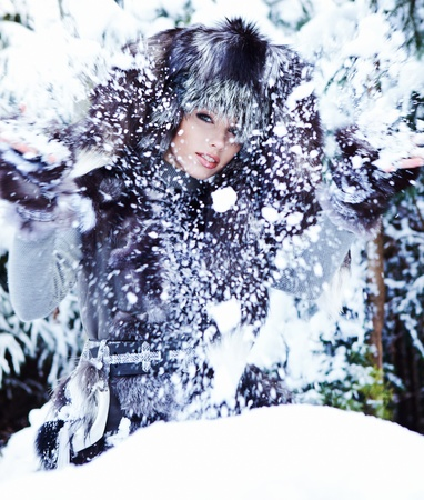 The beautiful woman in winter wood  photo