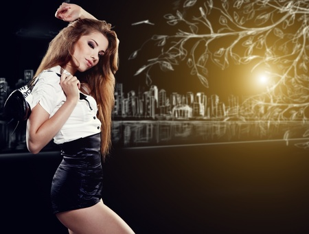 foot model: Beautiful woman after party holding shoes . Girl and shoe  Stock Photo
