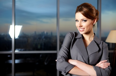 business suit: business woman in modern glass interior