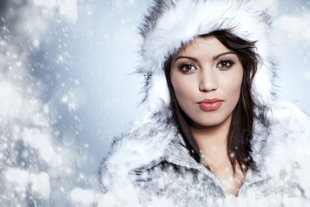portrait of winter woman with snow photo