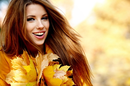 beautiful thanksgiving: Young woman in autumn orange leaves. Outdoor.