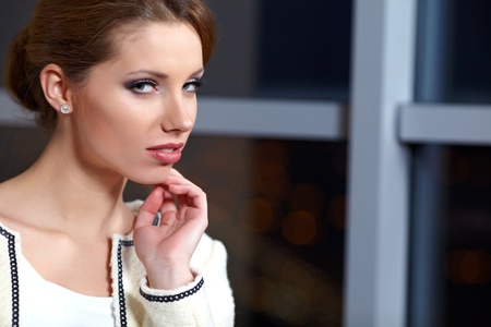 elegant woman  in a office interior  photo