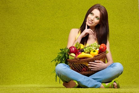 young woman shopping for vegetables photo