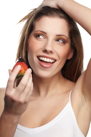 nutritive: portrait of lying down woman with a strawberry  Stock Photo