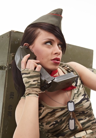 female soldier: Beautiful girl in military clothes. studio shot