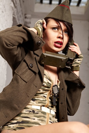 provocative women: Beautiful girl in military clothes. studio shot
