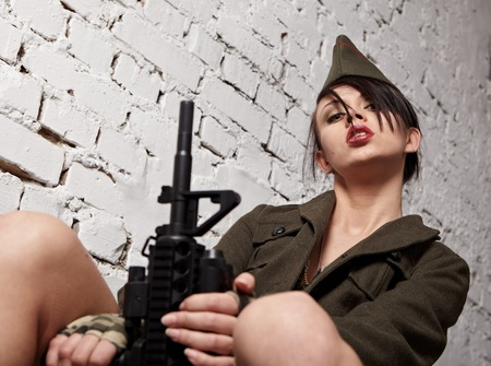 army girl: Beautiful girl in military clothes. studio shot