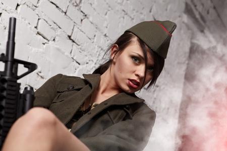 Beautiful girl in military clothes. studio shot  photo