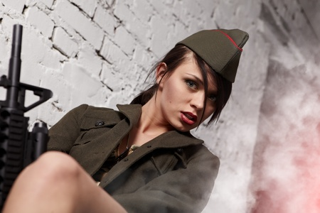 Beautiful girl in military clothes. studio shot  photo