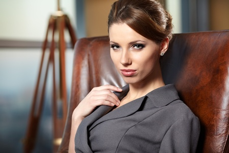 elegant businesswoman in a office interior  photo