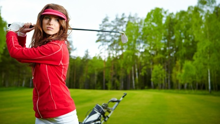 woman playing golf on a green  photo