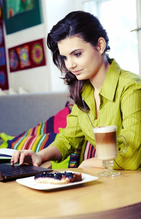 Beautiful young college student on a cafe.  photo
