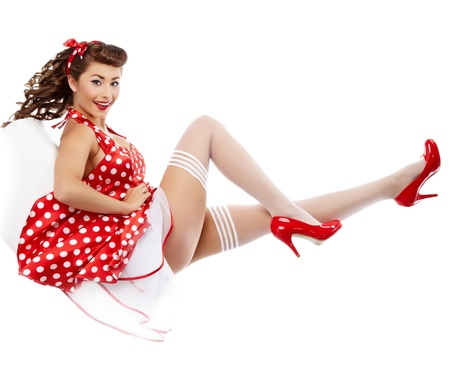 pinup: young beautiful caucasian woman posing, isolated over white, retro styling  Stock Photo