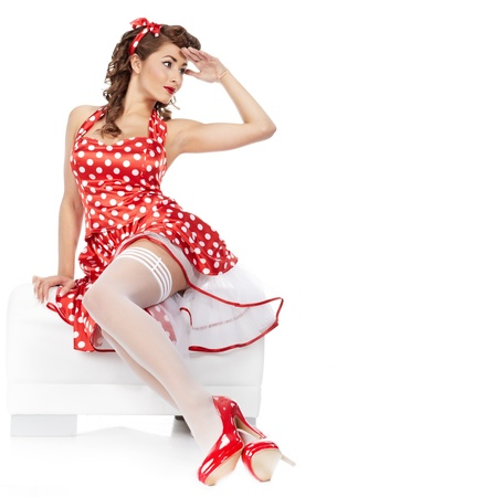 sexy housewife: beautiful young woman isolated on white in studio in old fashion clothes representing pinup and retro style