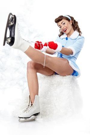 patinaje sobre hielo: Patinaje sobre hielo sexy pin-up de la mujer Foto de archivo