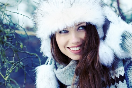 Beauty woman in the winter scenery  Stock Photo - 12351207