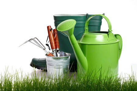 garden tools: Garden tools and watering can with grass on white  Stock Photo