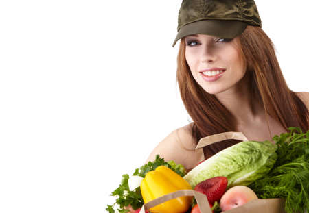 Smiling woman with fruits and vegetables. Over white background Stock Photo - 12351318