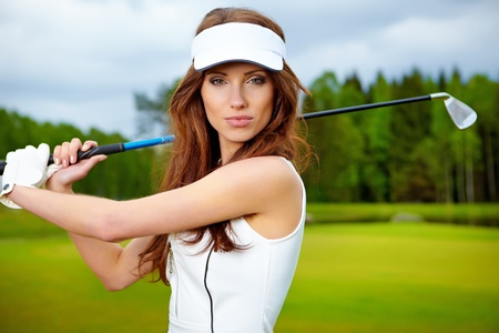 woman golf: Portrait of an elegant woman playing golf on a green