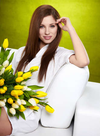 Portrait of a girl with white and yellow tulips photo