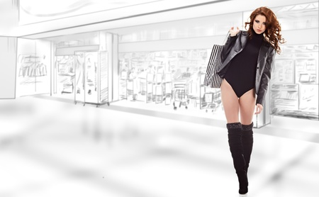 commercial activity: Beautiful shopping woman at a draw mall