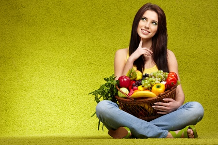 vegetables supermarket: Happy young woman with vegetables