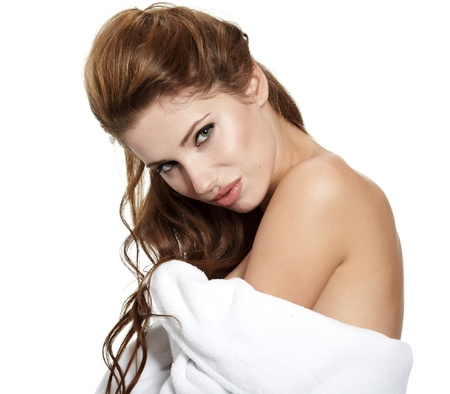 Beautiful Young Woman with fresh healthy skin applying moisturizer.Spa woman concept  photo