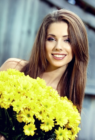 Happy smiling young woman with flower bouquet Stock Photo - 12766082