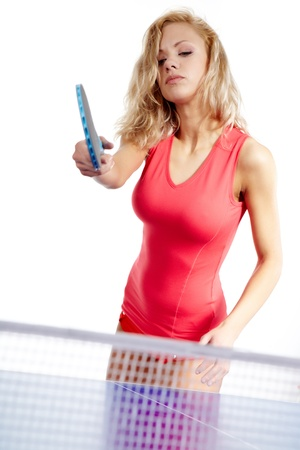 Sexy Sports girl plays table tennis  photo