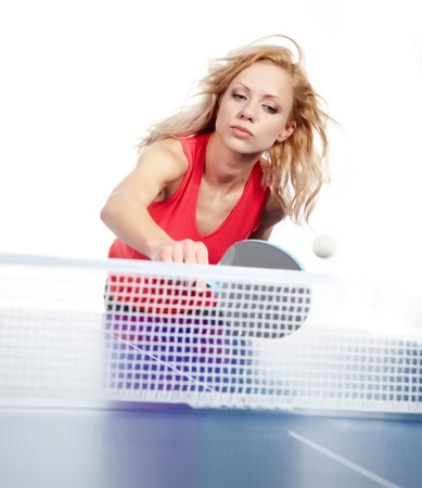 Sports girl plays table tennis  photo