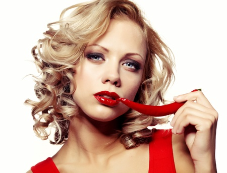 Sexy woman wearing red dress with chili pepper isolated on white  photo