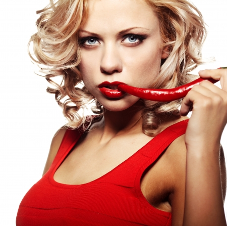 blonde close up: Sexy woman wearing red dress with chili pepper isolated on white  Stock Photo
