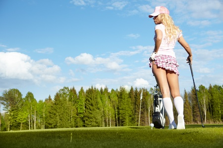 golf equipment: Young blonde  woman with golf equipment