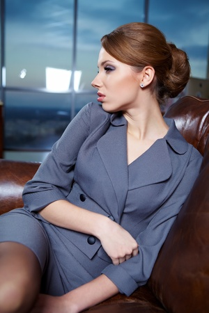 sexy businesswoman: A portrait of a young business woman in an office  Stock Photo