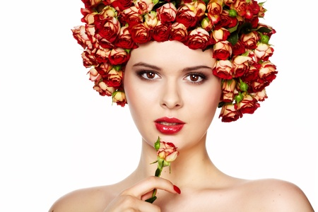 Portrait of young beautiful woman with roses in hair, on white background Stock Photo - 13231878