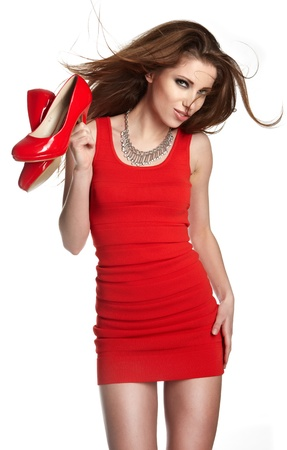 shoe model: Beautiful woman after shopping holding shoes . Girl and shoe