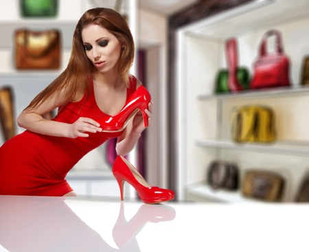women  in shop and thinking what shoes to buy Stock Photo - 13273741
