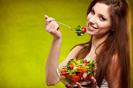 female of cute appearance eats vegetable vegetarian salad