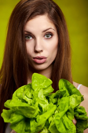 woman holding green lettuce  photo