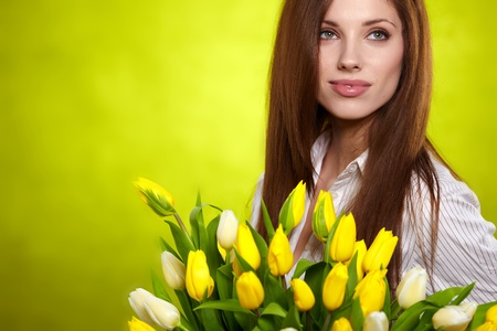 Portrait of beautiful woman with tulips  photo