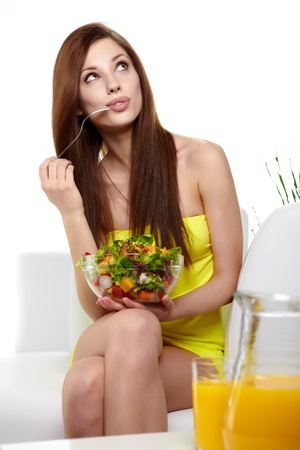 Young beauty woman eating fruit salad  photo